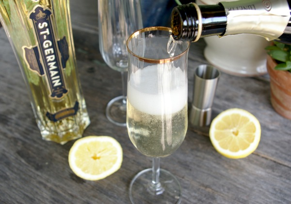 pouring champagne for french 77
